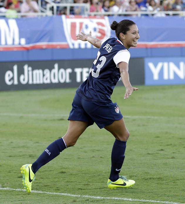 United States' Christen Press celebrates after scoring a goal against Russia during a friendly  international soccer match in Boca Raton, Fla., Saturday, Feb. 8, 2014. USA won 7-0