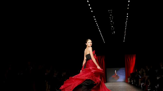 Olivia Culpo presents a creation during the American Heart Association's (AHA) Go Red For Women Red Dress Collection, presented by Macy's at New York Fashion Week.