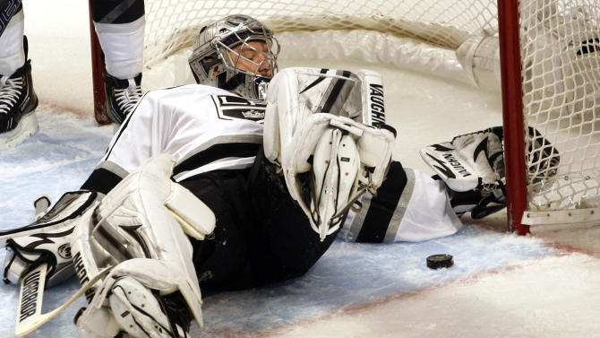 Los Angles Kings' goalie Jonathan Quick makes a save on a Chicago Blackhawks shot in the second period of an NHL hockey game on Sunday, Feb. 17, 2013, in Chicago. The  Blackhawks won 3-2. (AP Photo/John Smierciak)