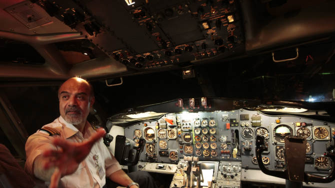 This undated photo provided by Captain Hooshang Shahbazi, shows him in a flight simulator at the Mehrabad airport in Tehran, Iran. Shahbazi, an Iranian pilot who guided an Iran Air Boeing passenger plane to a safe emergency landing last year has launched an individual campaign to lift Western sanctions that restrict the import of civilian plane spare parts. (AP Photo)