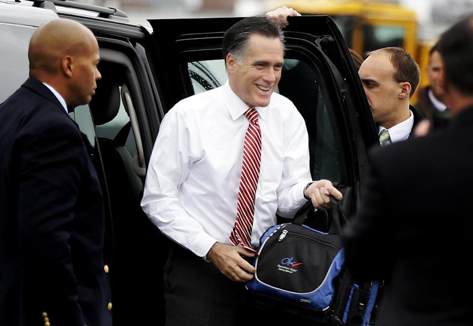 Republican presidential candidate, former Massachusetts Gov. Mitt Romney gets out of his vehicle before boarding his campaign plane at Toledo Express Airport in Toledo, Ohio, Friday, Oct. 26, 2012, as he travels to a campaign stop in Des Moines, Iowa. (AP Photo/Charles Dharapak)