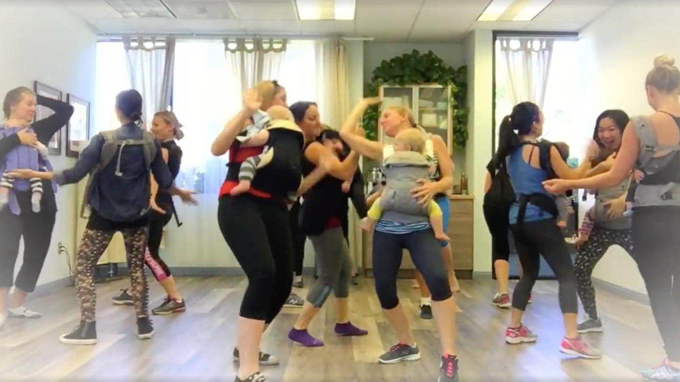 Parents and babies get down in a choreographed dance class