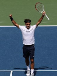 Roger Federer of Switzerland celebrates after defeating Novak Djokovic of Serbia during the final on day nine of the Western & Southern Open at the Lindner Family Tennis Cente in Mason, Ohio. Federer won his sixth title of the season as he beat second-seeded Djokovic 6-0, 7-6 (9/7)