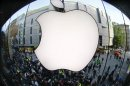 Customers gather outside an Apple store before the release of iPhone 5 in Munich