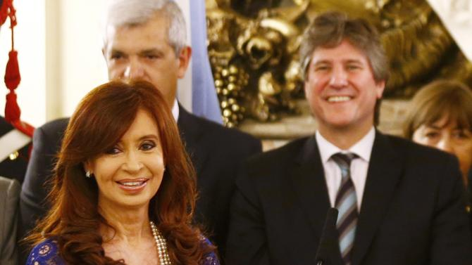 Argentina's President Cristina Fernandez de Kirchner and Vice President Amado Boudou smile during a ceremony in Buenos Aires