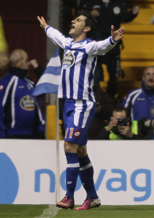 Deportivo La Coruna's Riki celebrates his goal against  Real Madrid during their Spanish First Division soccer match at the Riazor stadium in Coruna