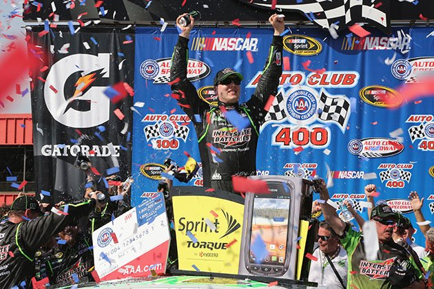 Kyle Busch celebrates victory after after winning the NASCAR Sprint Cup Series Auto Club 400 (Jerry Markland/Getty)