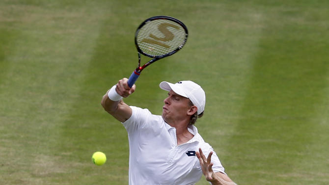Kevin Anderson of South Africa returns a ball to Novak Djokovic of Serbia during their singles match at the All England Lawn Tennis Championships in Wimbledon, London, Tuesday July 7, 2015. (AP Photo/Kirsty Wigglesworth)