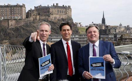 Scottish Labour Party Leader Murphy, Britain's opposition Labour Party leader Miliband and Shadow Chancellor Balls pose after a joint news conference in Edinburgh