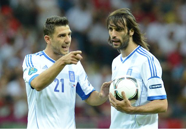 Greek Forward Giorgios Samaras And Greek Midfielder Kostas Katsouranis (R) Speak AFP/Getty Images
