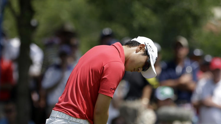 Sang-Moon Bae, of South Korea, reacts after sinking a putt on the second green during the third round of the Byron Nelson Championship golf tournament Saturday, May 18, 2013, in Irving, Texas. (AP Photo/Tony Gutierrez)