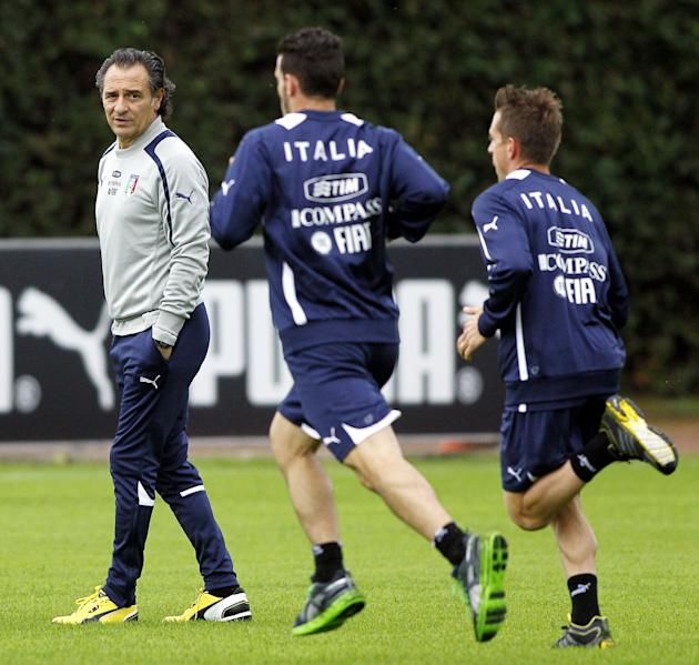 Italy coach Cesare Prandelli, left, attends a training session at the Coverciano training grounds, near Florence, Italy, Monday, Oct. 7, 2013. Italy is scheduled to play a World Cup qualifier soccer m