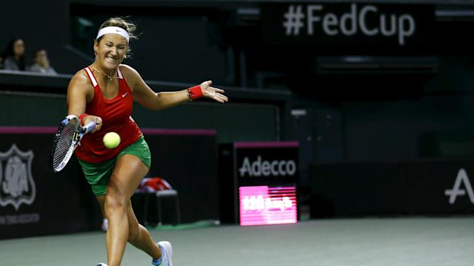 Azarenka of Belarus returns shot to Misaki Dori of Japan during their FedCup match in Tokyo
