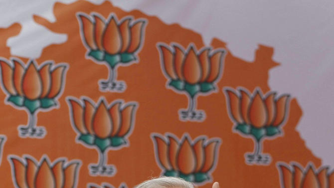 In this Nov. 30, 2012 photo, Gujarat Chief Minister Narendra Modi speaks during a public meeting before filing his nomination for state assembly elections in Ahmadabad, India. Eleven years after Modi became the chief minister of the western state of Gujarat - and 10 years after brutal anti-Muslim rioting left over a 1,100 people there dead - Modi is campaigning for his third term. Nearly everyone expects him to be swept into office, and the top leadership of his rightwing Bharatiya Janata Party is already hailing him as a future prime minister. But few politicians in India are as polarizing as Modi. (AP Photo/Ajit Solanki)