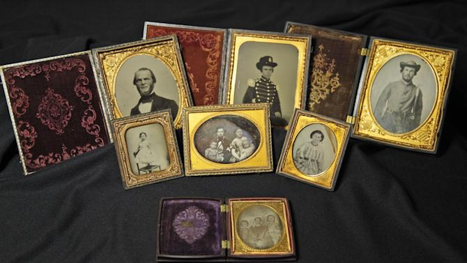 A group of seven Civil War battlefield photos at the museum in Richmond, Va., Friday, May 25, 2012. Eight photographs are publicly releasing the images in the admittedly remote chance a descendant might recognize a facial resemblance or make a connection the battlefields where they were found. (AP Photo/Steve Helber)