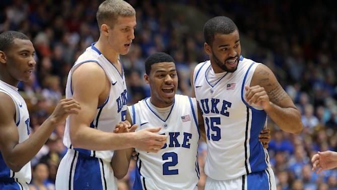 Duke players, from left, Rasheed Sulaimon, Mason Plumlee, Quinn Cook, and Josh Hairston huddle up during the second half of an NCAA college basketball game against Wake Forest in Durham, N.C., Saturday, Jan. 5, 2013.  Duke won 80-62. (AP Photo/Ted Richardson)