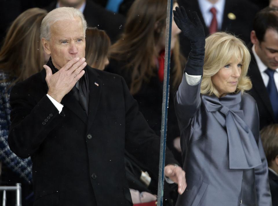 Vice President Joe Biden and his wife Jill Biden gesture to the crowd during the 57th Presidential Inauguration parade after the ceremonial swearing-in of President Barack Obama, Monday, Jan. 21, 2013, in Washington.  (AP Photo/Gerald Herbert)