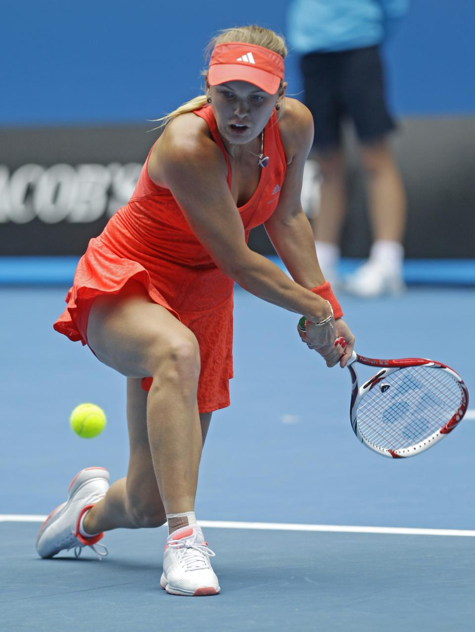 Denmark's Caroline Wozniacki makes a backhand return ro Romania's Monica Niculescu during their third round match at the Australian Open tennis championship, in Melbourne, Australia, Friday, Jan. 20, 2012. (AP Photo/Rick Rycroft)