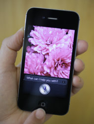 In this photo taken Monday Oct. 10, 2011, Siri, the new virtual assistant, is displayed on the new Apple iPhone 4S in San Francisco. The 4S will be available Friday in black or white. It will cost $199-$399, depending on included storage space, with a two-year service contract with Verizon Wireless, Sprint or AT&T. (AP Photo/Eric Risberg)