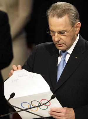 International Olympic Committee President Jacques Rogge opens the envelope announcing that Pyeongchang has won the bid to host the 2018 Olympic Winter Games in Durban, South Africa, Wednesday July 6, 2011. The IOC announced it voted for Pyeongchang to be the host city for the 2018 Winter Olympics.The IOC voted by secret ballot from a field of three candidates - Pyeongchang, South Korea; Munich; and Annecy, France. (AP Photo/Themba Hadebe)