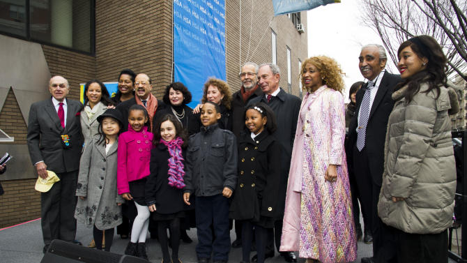 """IMAGE DISTRIBUTED FOR HARLEM SCHOOL OF THE ARTS - From left to right, Bob Levinson, Yvette L. Campbell, Janice Savin, Charles J. Hamilton, Rona Sebastian, Lani Hall, Herb Albert, Mayor Michael R. Bloomberg, N'Kenge, Charles B. Rangel, Busisiwe Zamisa and students from the school attend the """"Harlem School of the Arts - The Herb Alpert Center"""" building naming ceremony, on Monday, March 11, 2013 in New York. (Photo by Charles Sykes/Invision for Harlem School of the Arts/AP Images)"""