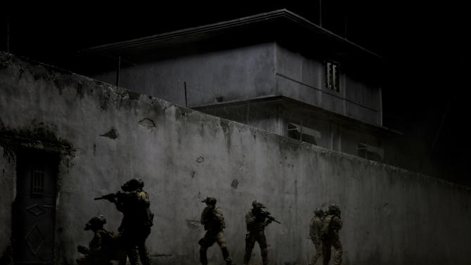 "FILE - This undated publicity film image provided by Columbia Pictures Industries, Inc. shows elite Navy SEALs raiding Osama Bin Laden's compound in the dark night in Columbia Pictures' gripping new thriller directed by Kathryn Bigelow, ""Zero Dark Thirty."" Bigelow's Osama bin Laden thriller ""Zero Dark Thirty,"" Steven Spielberg's Civil War epic ""Lincoln"" and Christopher Nolan's superhero tale ""The Dark Knight Rises"" are among the American Film Institute's top-10 movies of the year., announced on Monday, Dec. 10, 2012. (AP Photo/Columbia Pictures Industries, Inc., Jonathan Olley, File)"