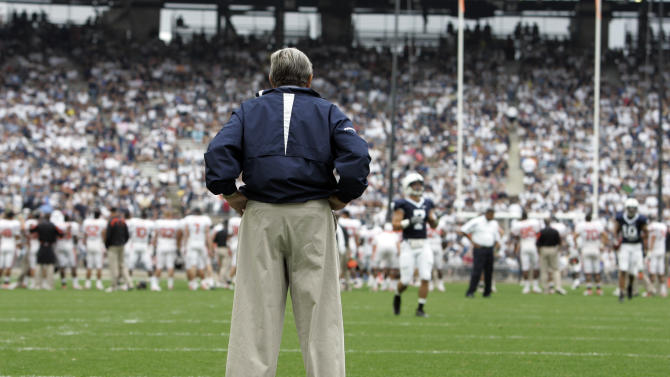 """FILE - In this Sept. 6, 2008 file photo, Penn State coach Joe Paterno surveys the field before an NCAA college football game against Oregon State at Beaver Stadium in State College, Pa. NCAA president Mark Emmert says he isn't ruling out the possibility of shutting down the Penn State football program in the wake of the Jerry Sandusky child sex abuse scandal.  In a PBS interview Monday night, July 16, 2012,  he said he doesn't want to """"take anything off the table"""" if the NCAA determines penalties against Penn State are warranted. (AP Photo/Carolyn Kaster, File)"""
