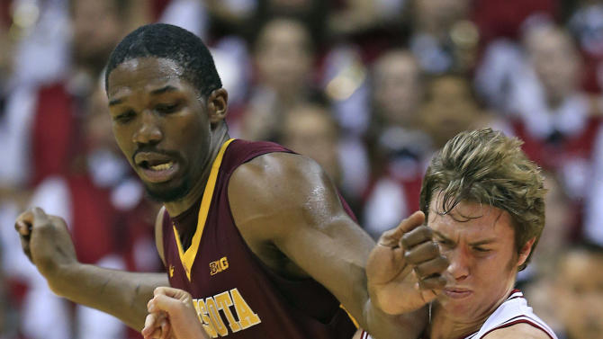 Indiana's Jordan Hulls (1) works the ball against Minnesota's Trevor Mbakwe (32) during the first half of an NCAA college basketball game, Saturday, Jan. 12, 2013, in Bloomington, Ind. (AP Photo/Darron Cummings)