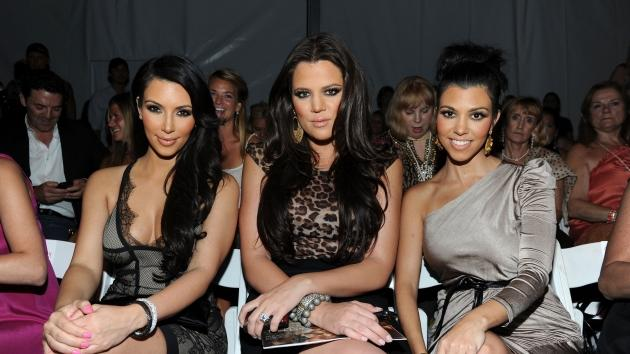 Kim, Khloe and Kourtney Kardashian attend the Beach Bunny Swimwear 2011 fashion show during Mercedes-Benz Fashion Week Swim at The Raleigh, Miami Beach, July 16, 2010  -- Getty Images
