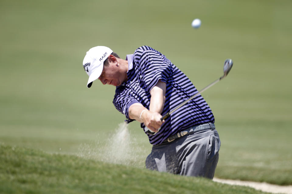 J.J. Henry hits from a bunker along the fourth fairway during the final round of the PGA Byron Nelson Championship golf tournament on Sunday, May 20, 2012, in Irving, Texas. (AP Photo/Tony Gutierrez)