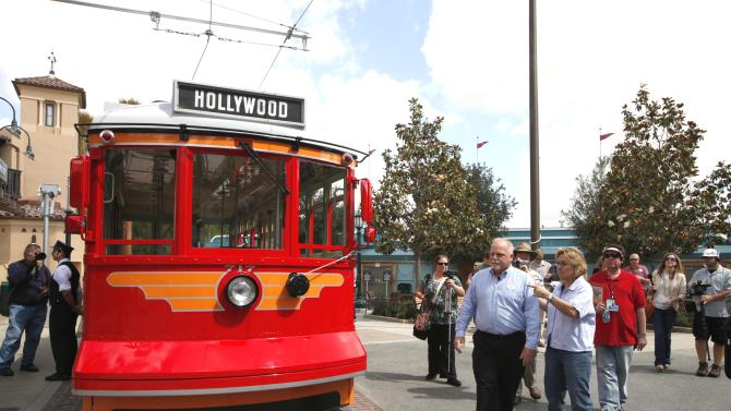 "This June 5, 2012 photo shows Ray Spencer, creative director of Buena Vista Street, and  Lisa Girolami, senior show producer, right, during a media tour os Buena Vista Street at Disney California Adventure Park in Anaheim, Calif.  The park's five-year, $1 billion-plus revamp has debuted in spurts since 2008. Most of its new features rely on characters that come from Disney's $7.4 billion acquisition of Pixar Animation Studios, the San Francisco-area studio behind ""Cars,"" `'Toy Story,"" `'Monsters Inc."" and ""A Bug's Life."" (AP Photo/Nick Ut)"