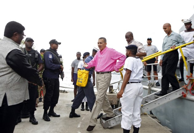 Newly appointed Trinidad and Tobago's President Carmona arrives for the re-enactment of the arrival of indentured East Indian labourers, to mark Indian Arrival Day, on Nelson Island