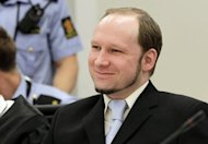 Mass killer Anders Behring Breivik smiles during his trial in room 250 of Oslo's central court on Thursday. Breivik, who killed 77 people in Norway last July, should be locked up in a psychiatric ward instead of prison, the prosecution said Thursday, arguing his sanity had not been proven beyond a reasonable doubt