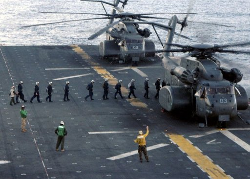 This US Navy handout photo received in 2005 shows, sailors as they board an MH-53E Sea Dragon. A US Navy helicopter crashed on Thursday in Oman during a transport mission, and the fate of its five-member crew is unknown, the US military said, ruling out an attack