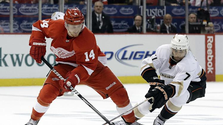 Detroit Red Wings center Gustav Nyquist (14), of Sweden,  and Anaheim Ducks center Andrew Cogliano (7) battle for the puck in the second period in Game 6 of a first-round NHL hockey Stanley Cup playoff series in Detroit, Friday, May 10, 2013. (AP Photo/Paul Sancya)