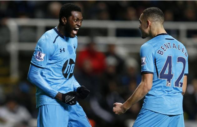 Tottenham Hotspur's Emmanuel Adebayor celebrates his goal against Newcastle United with Nabil Bentaleb during their English Premier League soccer match at St James' Park in Newcastle