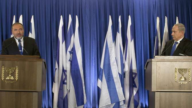 Israeli Prime Minister Benjamin Netanyahu, right, and Foreign Minister Avigdor Lieberman give a statement in Jerusalem, Thursday, Oct. 25, 2012. Netanyahu said his Likud Party will join forces with the hard-line party of his Foreign Minister in upcoming parliamentary elections. (AP Photo/Bernat Armangue)