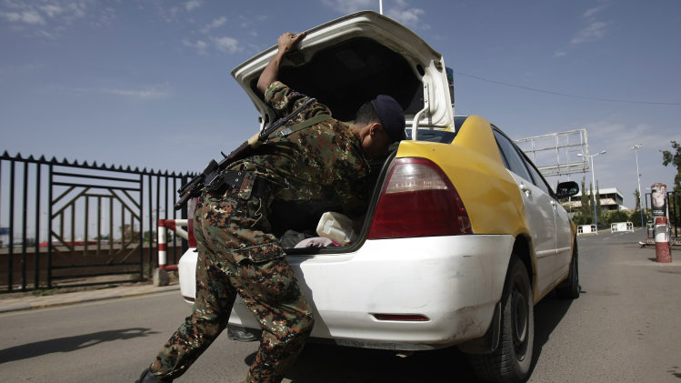 "A policeman checks a car at the entrance of Sanaa International Airport, in Yemen, Wednesday, Aug. 7, 2013. The State Department on Tuesday ordered non-essential personnel at the U.S. Embassy in Yemen to leave the country. The department said in a travel warning that it had ordered the departure of non-emergency U.S. government personnel from Yemen ""due to the continued potential for terrorist attacks"" and said U.S. citizens in Yemen should leave immediately because of an ""extremely high"" security threat level. (AP Photo/Hani Mohammed)"