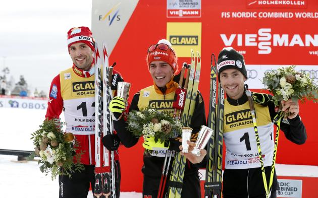 Medallists pose at the men's nordic combined event at the Holmenkollen World Cup 2014