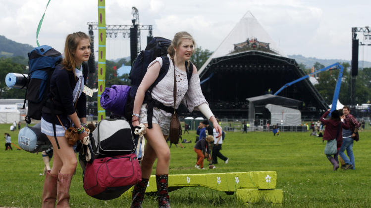 Thousands of music fans descend on Glastonbury