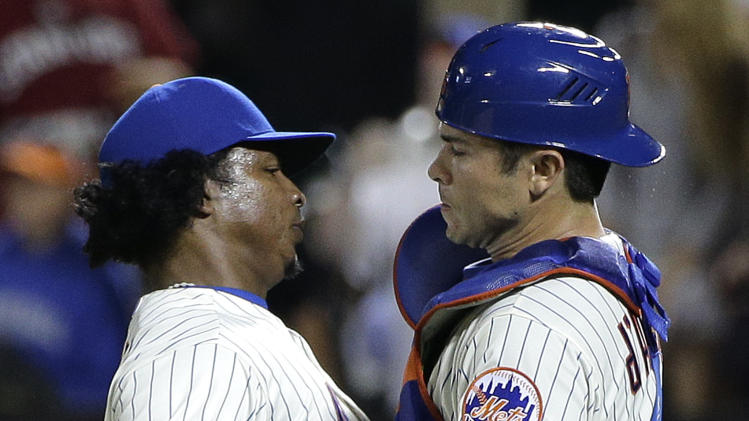 New York Mets pitcher Jenrry Mejia, left, bumps chests with catcher Travis d'Arnaud after closing out the ninth inning for a save against the Atlanta Braves in a baseball game, Wednesday, July 9, 2014, in New York. The Mets won 4-1. (AP Photo/Julie Jacobson)