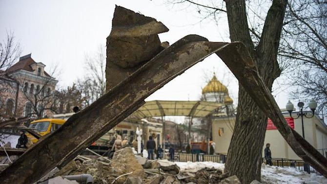 Debris of flattened kiosks scatters near the Christ the Saviour Cathedral, seen in the background, in downtown Moscow, Wednesday, Feb. 10, 2016.  Russian activists and political commentators have criticized Moscow authorities over the late-night destruction of kiosks around the city. About half of Moscow's 104 kiosks, which sell items from ranging from pastries and flowers to trinkets and kebabs, were flattened Monday evening. (AP Photo/Alexander Zemlianichenko)