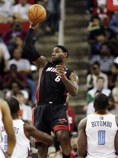 Heat beat Bobcats 98-92 in preseason game