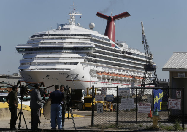 The cruise ship Carnival Triumph is moored at a dock in Mobile, Ala., Friday, Feb. 15, 2013. The ship, which docked Thursday in Mobile after drifting nearly powerless in the Gulf of Mexico for five da