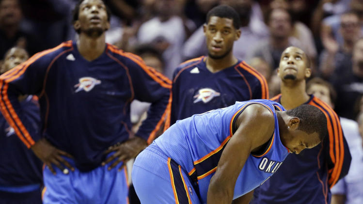Oklahoma City Thunder's Serge Ibaka, foreground, and teammates react after losing in the last second of an NBA basketball game against the San Antonio Spurs, Thursday, Nov. 1, 2012, in San Antonio. San Antonio won 86-84. (AP Photo/Eric Gay)