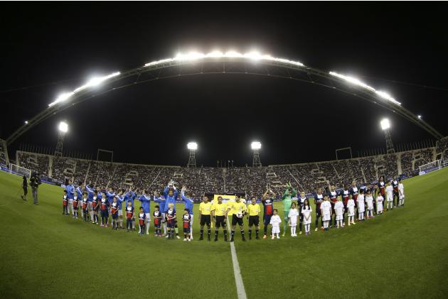 Paris St Germain's and Real Madrid's players pose before their friendly soccer match at Khalifa stadium in Doha