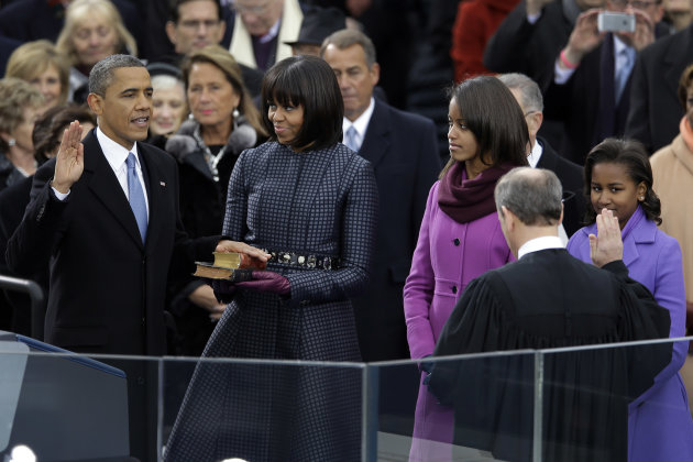President Barack Obama receives the oath of office from Chief Justice John Roberts at the ceremonial swearing-in at the U.S. Capitol during the 57th Presidential Inauguration in Washington, Monday, Jan. 21, 2013. First Lady Michelle Obama holds the bible as daughters Malia and Sasha watch. (AP Photo/Carolyn Kaster)
