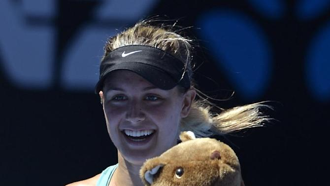 Eugenie Bouchard of Canada, holding stuffed animal of wombat, celebrates after defeating Ana Ivanovic of Serbia during their quarterfinal at the Australian Open tennis championship in Melbourne, Australia, Tuesday, Jan. 21, 2014