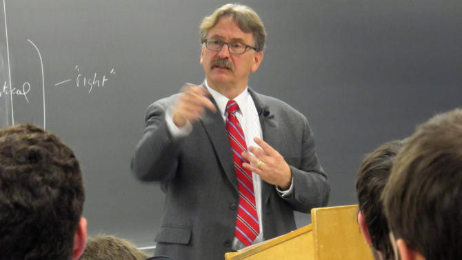 "In this Nov. 27, 2012 photo Marquette University professor Tim Machan teaches a class on J.R.R. Tolkien that focuses on all of his books, books that influenced Tolkien and other tidbits about the writer. When ""The Hobbit"" movie opens Friday, the 32 students in the class will be nearly experts on J.R.R. Tolkien. (AP Photo/Carrie Antlfinger)"