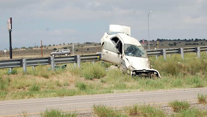 This Photo provided by Huerfano Journal, shows a car that was driven by three fugitive siblings crashed on a highway barrier on Wednesday, Aug. 10, 2011 in Walsenburg, Colo..   The trio, Ryan Edward Dougherty, 21; Dylan Dougherty Stanley, 26; and Lee Grace Dougherty, 29, had been targets of a nationwide search after alleged crimes last week in which they were accused of shooting at a police car during a chase and robbing a bank with assault weapons.  The three fugitives were captured Wednesday in Colorado after leading officers on a high-speed chase.   (AP Photo/Huerfano Journal , Bill Knowles)  NO SALES